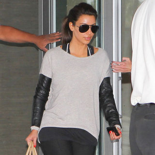 Kim Kardashian Wearing Leather-Sleeved Sweater
