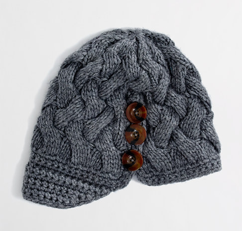 With just a hint of a paperboy cap silhouette, we love that this J.Crew Factory cap ($24) got the three-button cable-knit treatment.