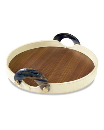 Horn handles, brass details, and leather accents give the Falconi Round Tray ($250) a cool, masculine style.