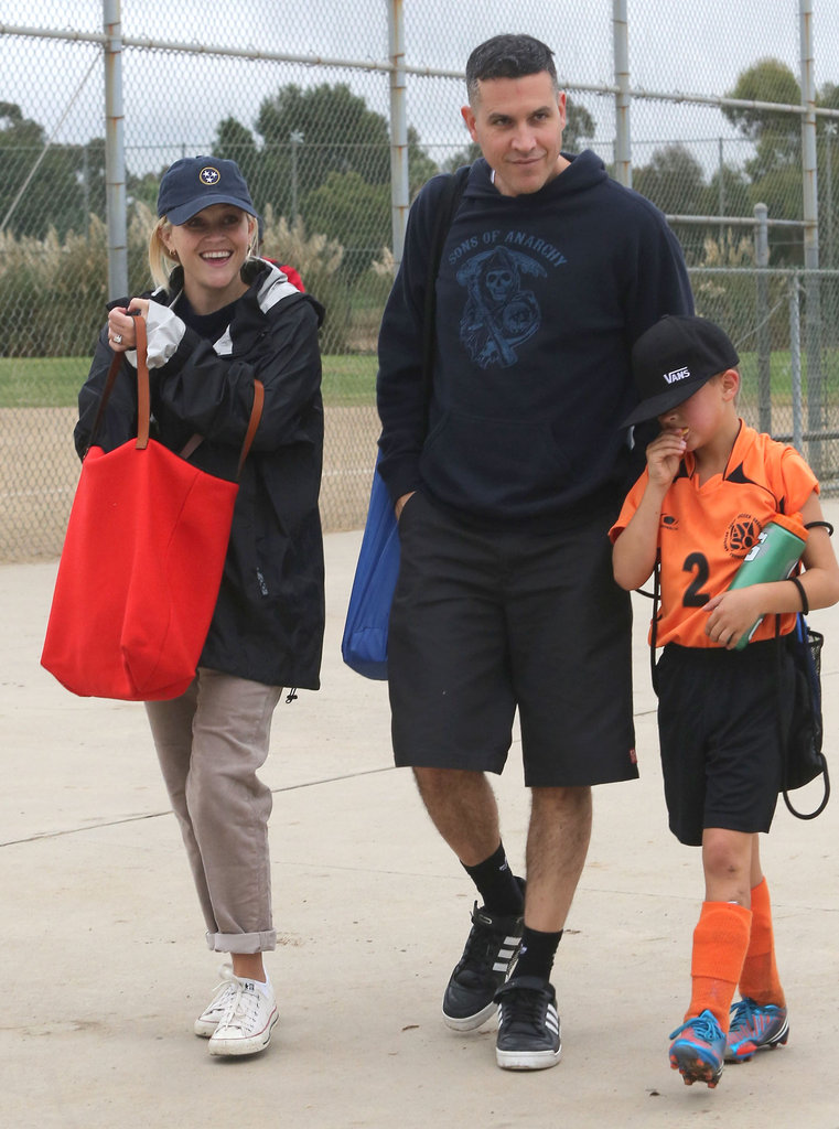 Jim Toth and Reese Witherspoon smiled on their way to Deacon's soccer game in LA.