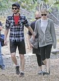 Andrew Garfield and Emma Stone held hands while out for a hike at Wilacre Park in LA yesterday.