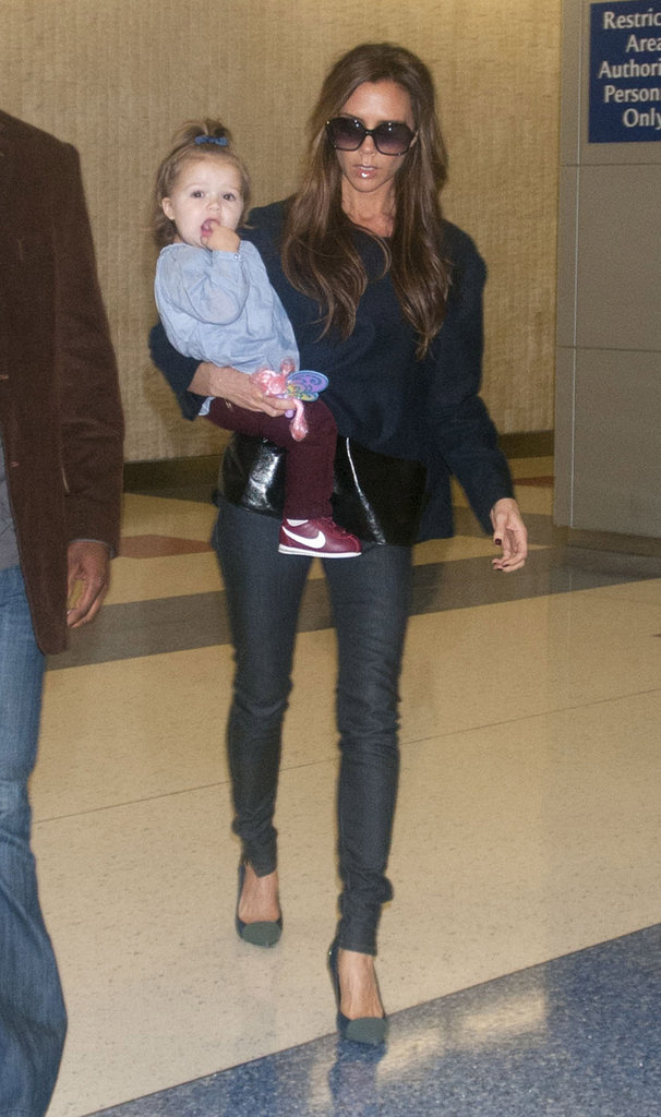 Victoria Beckham and daughter Harper arrived at JFK.