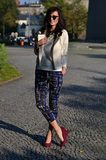 Printed pants shake up a polished jacket and give her burgundy heels a bold colour counterpoint. Source: Lookbook.nu
