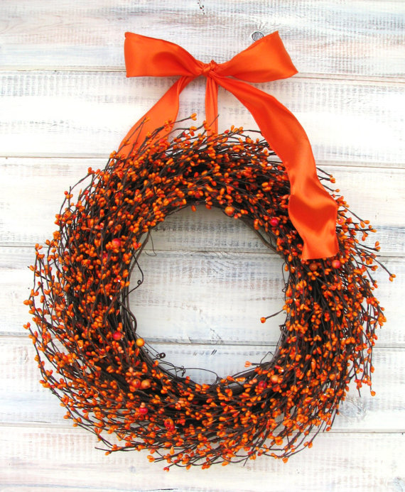The bright color and orange aroma of this Rustic Grapevine Wreath ($59) will pop against any front door but could also be used as a focal point above your mantel.