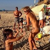 Bar Refeali got into a water fight with a pint-size pal on the beach. Source: Instagram user barrefaeli