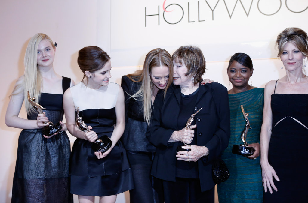 Elle Fanning, Emma Watson, Uma Thurman, Shirley Maclaine, Octavia Spencer, and Robbie Myers posed on stage with their awards at the Elle Women in Hollywood Awards.