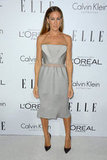 Sarah Jessica Parker kept it sleek in a silvery-hued Calvin Klein Spring '13 strapless dress with a sheer inset at the waist and pointed-toe pumps to complete the look.
