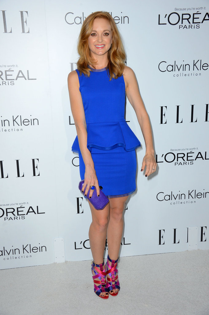 Jayma Mays went for bright color all around, choosing a peplum-trimmed cobalt sheath and strappy multicolored sandals to complement.