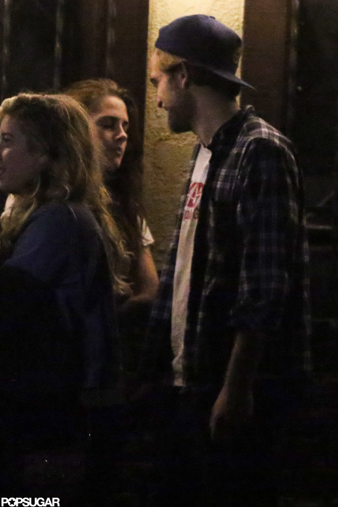 Robert Pattinson and Kristen Stewart talked outside a bar.