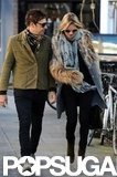 Kate Moss wore a gray jacket with fur detailing and a printed scarf in London.