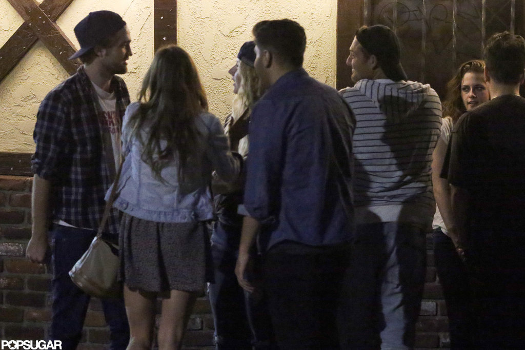 Robert Pattinson and Kristen Stewart hung out with friends.