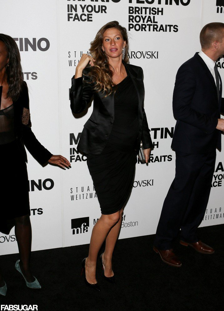 Gisele looked minimally chic last night in a black one-shoulder Halston dress, satin Tom Ford blazer, and black patent Christian Louboutin pumps.