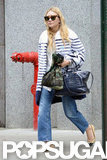 Ashley Olsen took to the sidewalk in NYC.