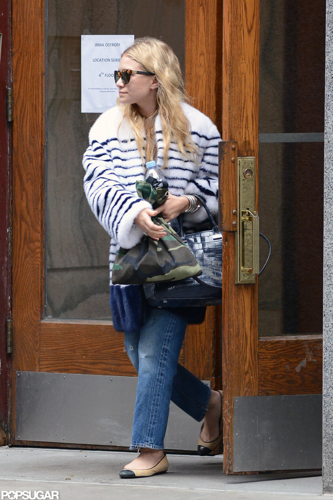 Ashley Olsen walked out of a building in SoHo.