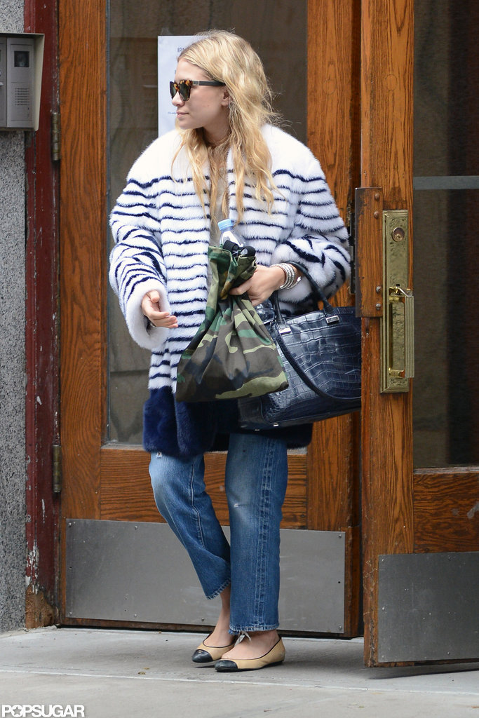 Ashley Olsen made her way onto the sidewalk in NYC.