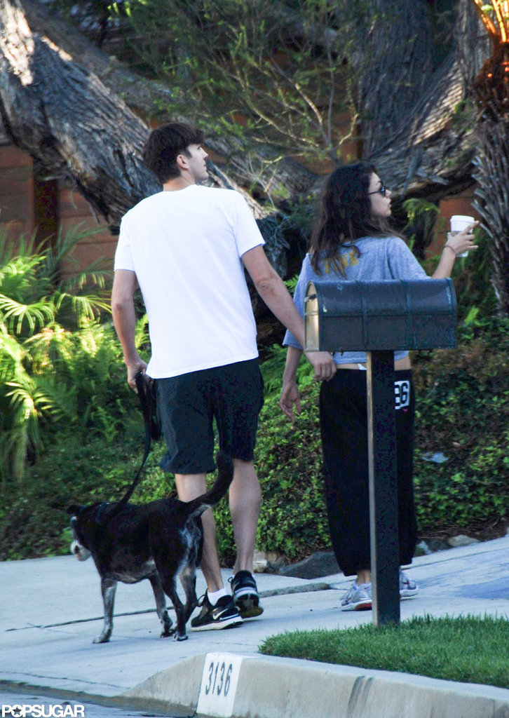 Ashton Kutcher and Mila Kunis took a walk together in LA with his dog.