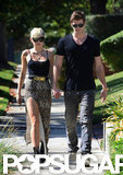 Miley Cyrus and Liam Hemsworth held hands.