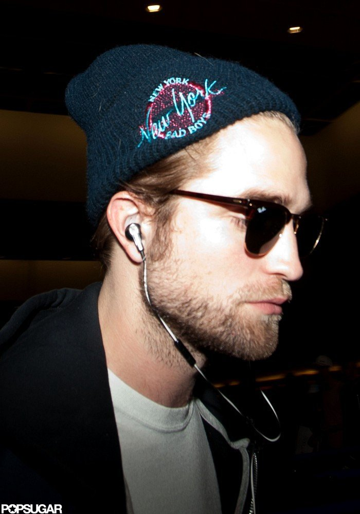 Robert Pattinson had his earbuds in.