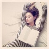 Only Miranda could make a standard book-in-bed shot look so glam. Source: Instagram user mirandakerrverified