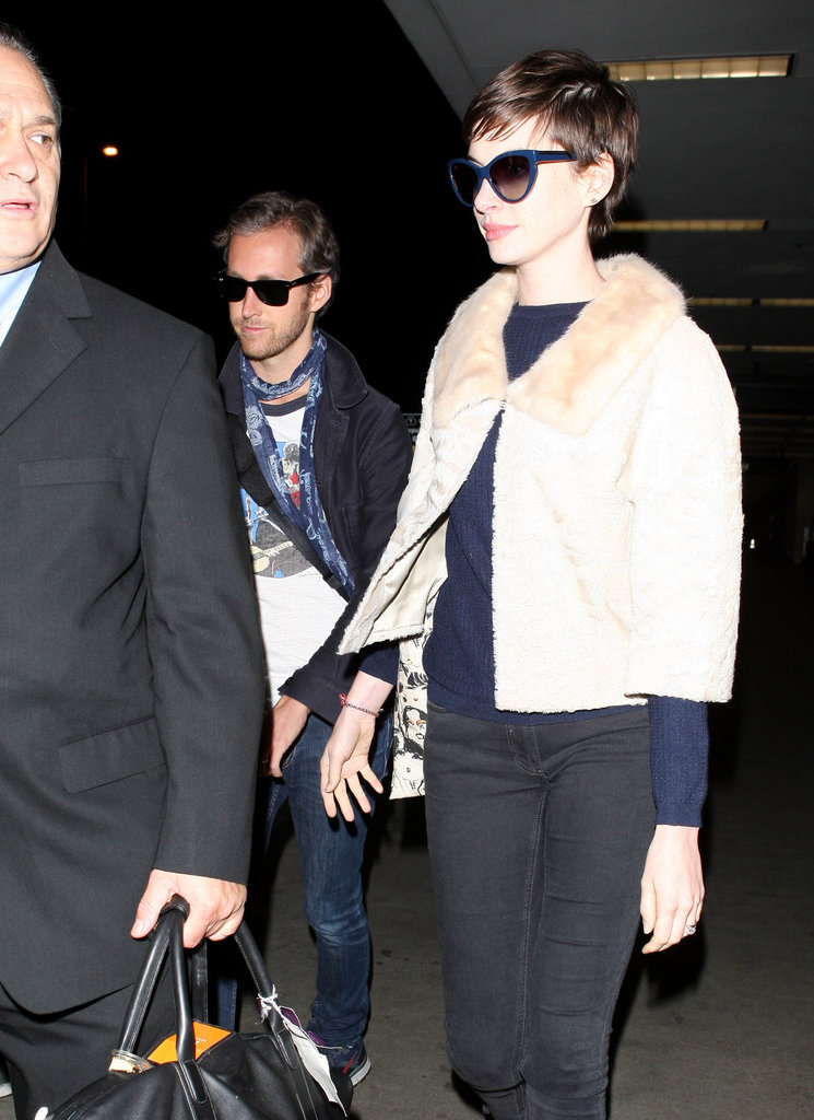 Anne Hathaway wore sunglasses at LAX.