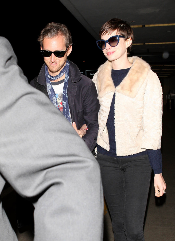Anne Hathaway and Adam Shulman were smiling big when they touched down at LAX in October 2012 after their honeymoon.
