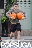 Hugh Dancy carried two large pumpkins in Toronto.