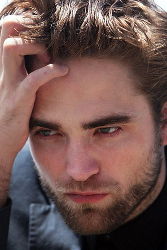 Robert Pattinson posed at a photo shoot in Sydney.