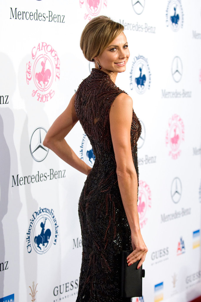 Keibler perfected her red carpet pose — we love that the gorgeous all-over beading comes all the way up to a high neckline at the back, adding more drama.