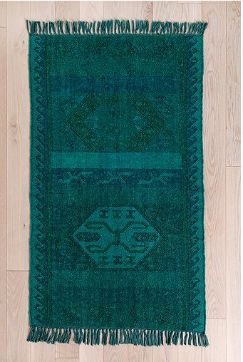 An ideal size for resting at the foot of the kitchen sink or next to a bed, this  Magical Thinking Overdyed Kilim Rug ($119) also comes at an unbeatable price.