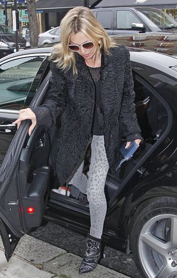 Kate Moss stepped out of a car wearing black boots.