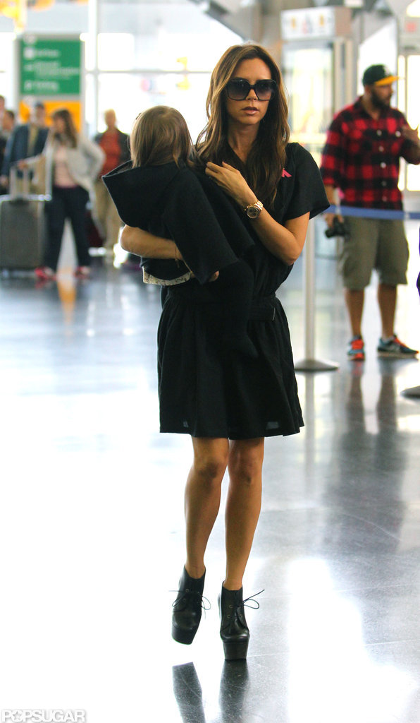 Victoria Beckham had a travel partner in Harper Beckham.