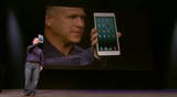 Phil Schiller, senior vice president of worldwide marketing at Apple, holds the iPad Mini.