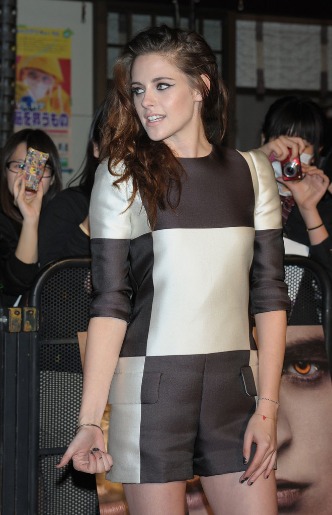 Kristen Stewart posed for photos at an event to promote Breaking Dawn Part 2 in Japan.