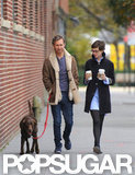 Anne Hathaway chose a black coat to walk in Brooklyn.