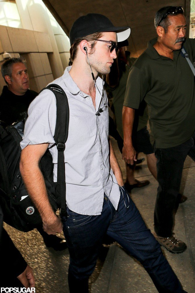 Robert Pattinson switched into a baseball cap.