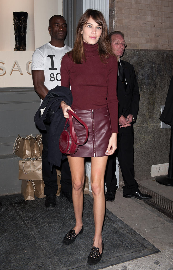 Alexa Chung adopted the look with a Versus leather skirt in Fall's rich burgundy hue.
