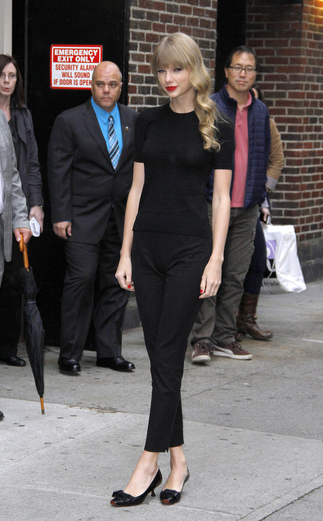 Taylor Swift showed off a sweet play on all black while heading into The Late Show.