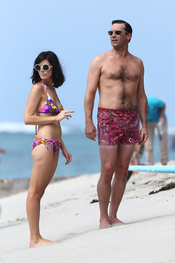 Jon Hamm and Jessica Paré look great in their colorful swimwear.