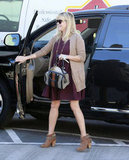 Reese Witherspoon stepped out of her car.