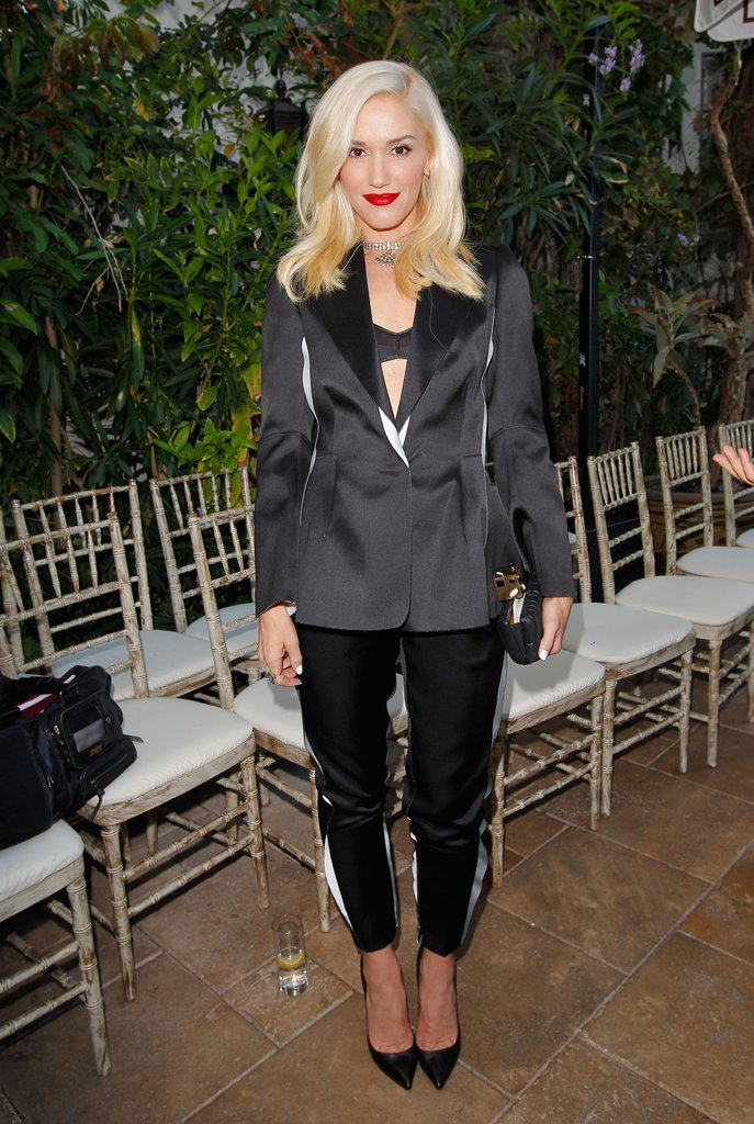 Gwen Stefani gave sleek suit separates a sexy twist with an exposed bra top underneath.