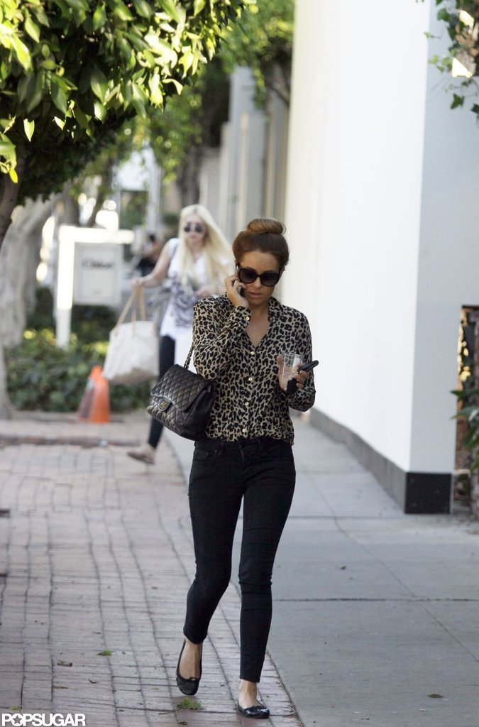 Lauren Conrad paired an animal-print shirt with denim for a stylish shopping trip in LA.