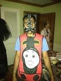 Aziz Ansari mixed up his Thomas the Tank Engine outfit with a mask.  Source: Twitter user azizansari