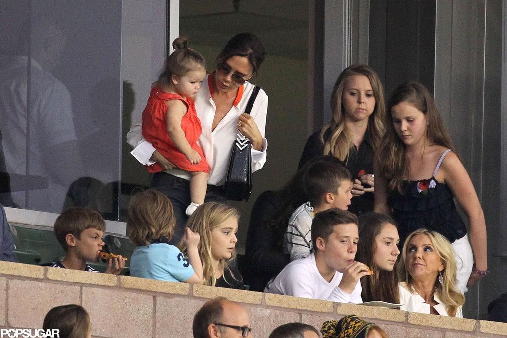 Victoria Beckham carried daughter Harper in LA.