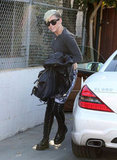 Miley Cyrus hopped out of her car and headed to the studio.