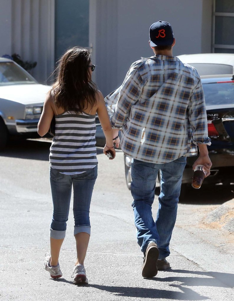 Ashton Kutcher and Mila Kunis stuck close by each other while out in LA.