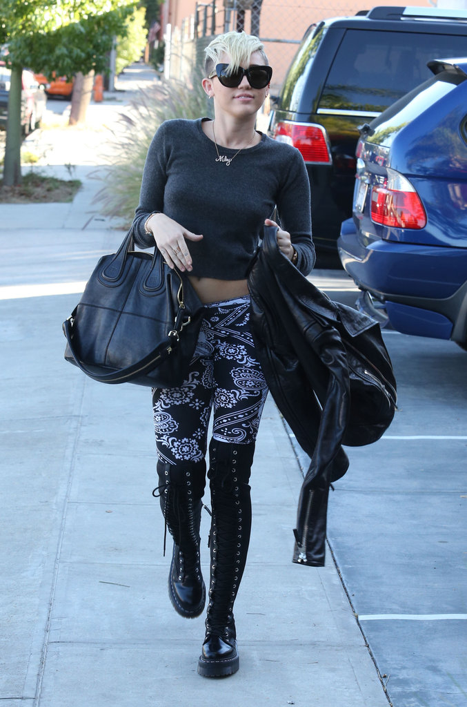 Miley Cyrus sported printed pants and boots.