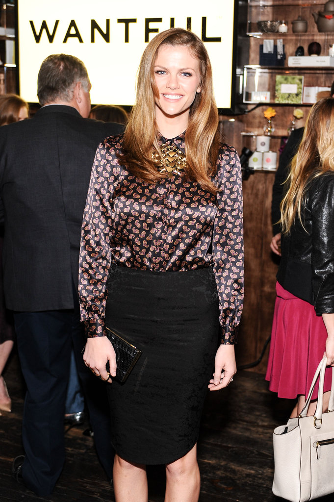 Brooklyn Decker wore a purple silk top and black pencil skirt.