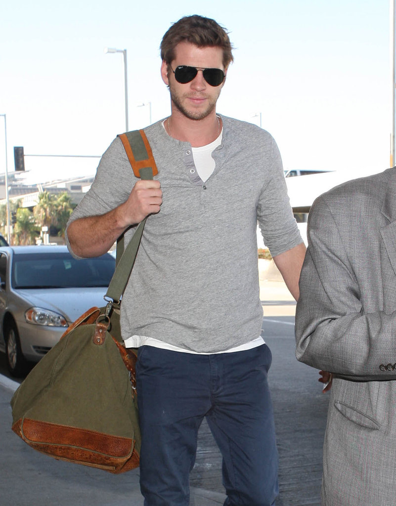 Liam Hemsworth was at the airport in LA.