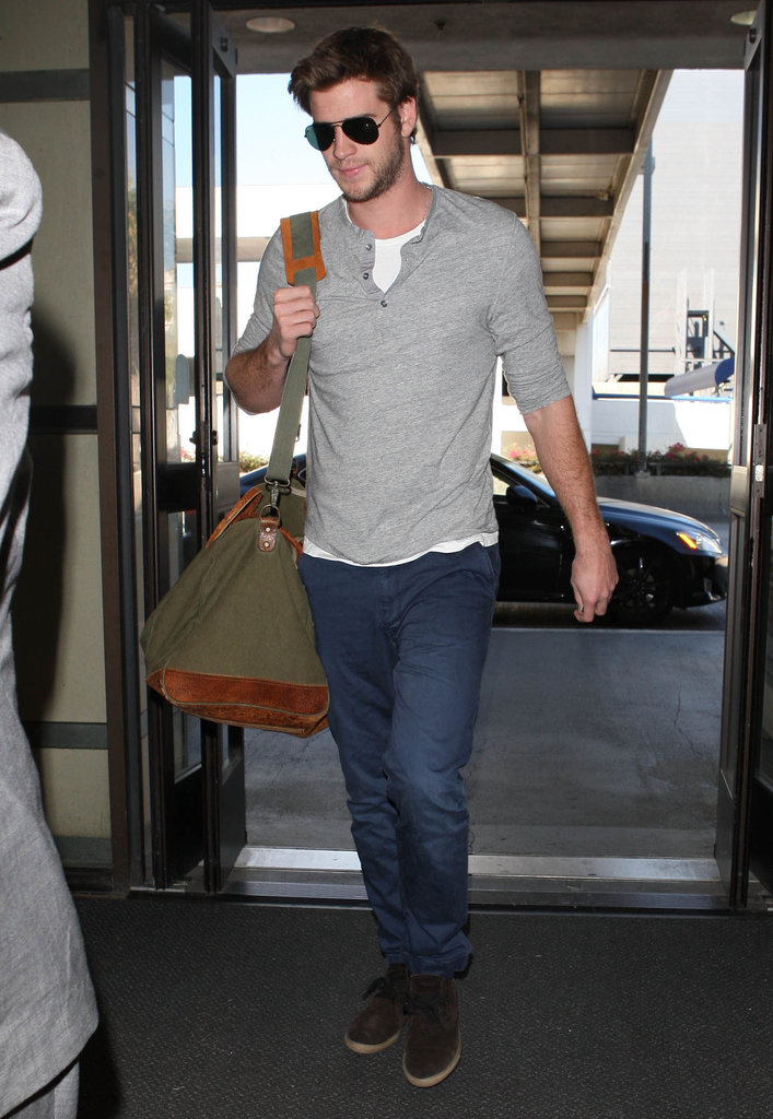Liam Hemsworth wore sunglasses at the airport in LA.