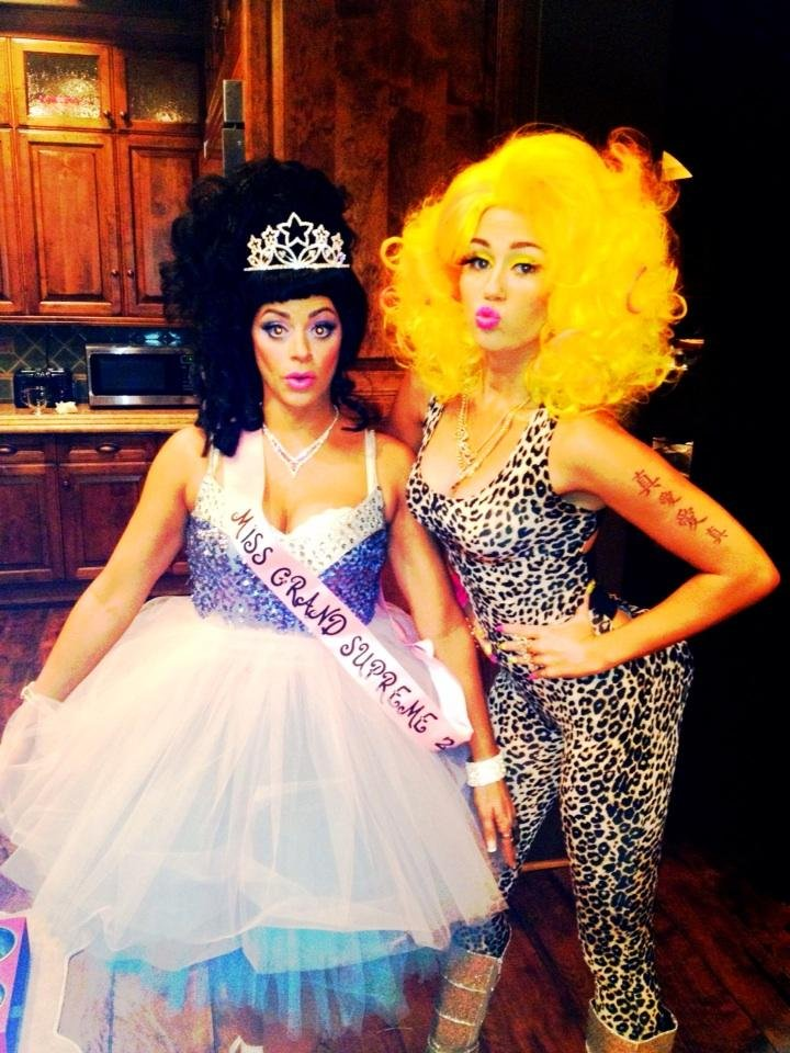 Miley Cyrus slipped into a wig and catsuit to dress up as Nicki Minaj. Source: Twitter user MileyCyrus